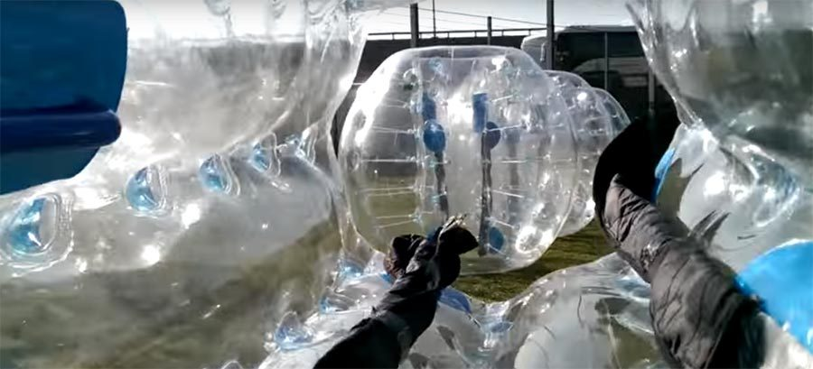 John encased inside a plastic bubble football