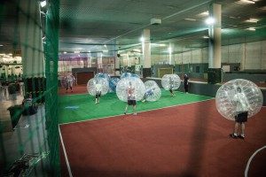 Group playing bubble football in Whitechapel, London