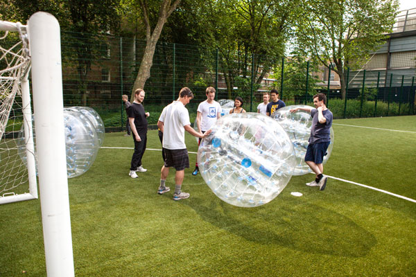 A Bubble London instructor taking a group through the safety briefing and rules of the game
